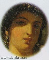 Лицо женщины погружено в тень.